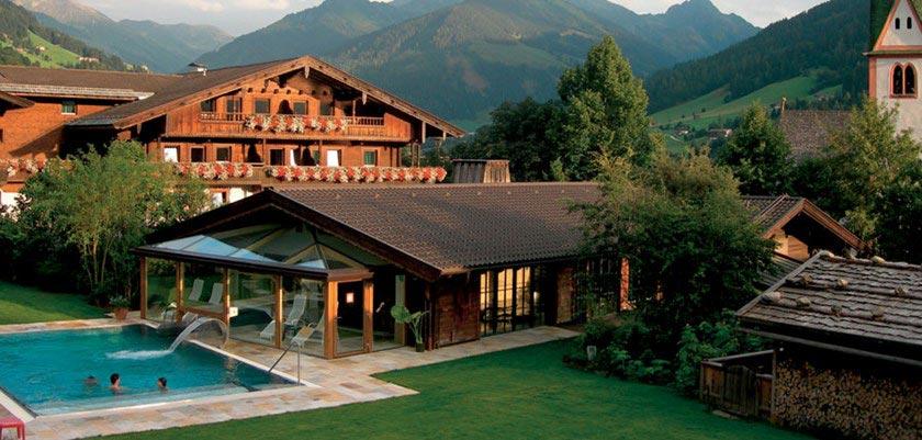 View of the Romantik-Hotel Böglerhof, exterior with outdoor pool.jpg